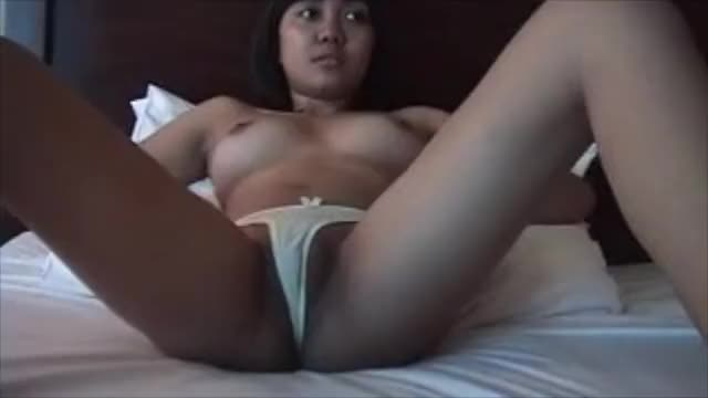 Asian girl takes off her panties, shows her pussy on webcam